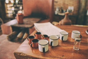 wood-table-hut-cups_unsplash_CC0license